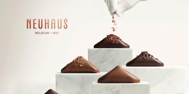 Photo of Het cultiveren van een verwennende ervaring online. Wereldwijd gerenommeerde chocolatiers, Neuhaus, combineren